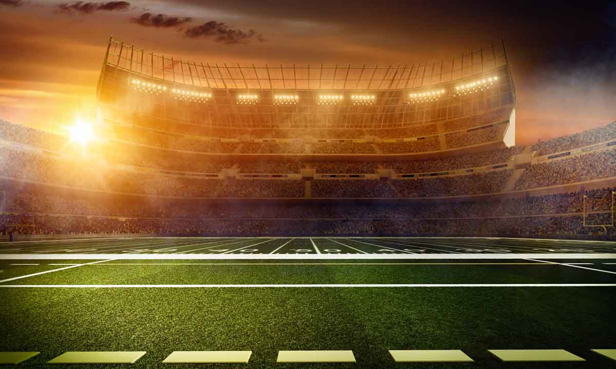 football stadium with sun rise in the background